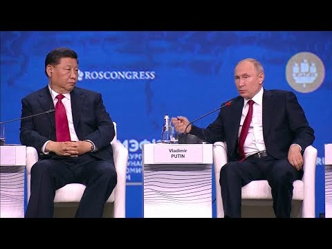 Putin, Xi hit back at US dominance at Russia economic forum