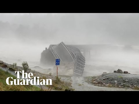 A New Zealand bridge is swept away in torrential rain and flooding on the South Island