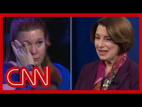 Klobuchar's story brings mass shooting survivor to tears | CNN Town Hall