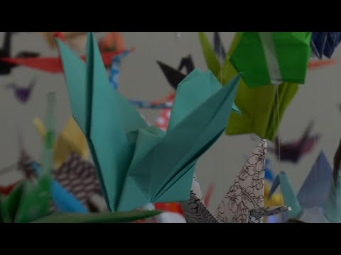 Associated Press: Artist creates origami memorial for virus victims