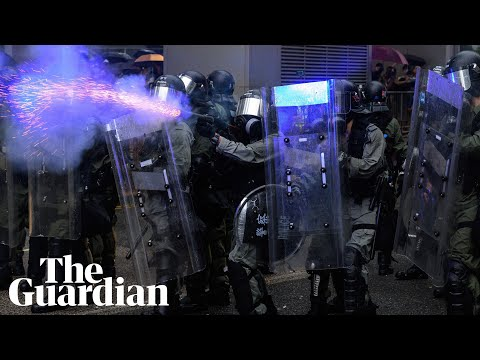 Police draw guns and deploy water cannon in clashes with Hong Kong protesters