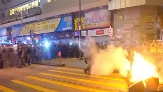 Radical protesters occupy streets, attack police in Hong Kong