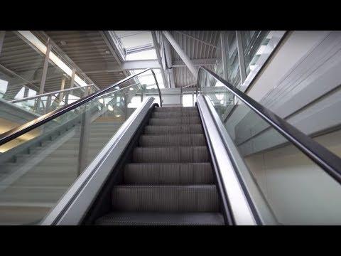 Poland, Warsaw Chopin Airport, going to gate 44, 1X elevator, 1X escalator, 2X movinc sidewalk