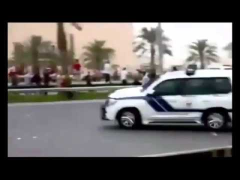Bahrain police trying to run over protesters
