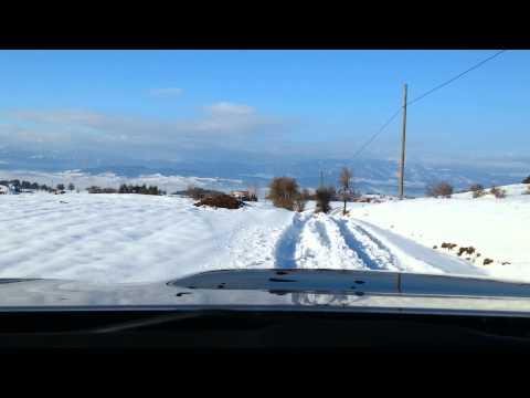 Subaru Outback in deep snow (Toyo Snowprox 953 tires)
