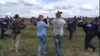 Journalist Caught on Camera Kicking Immigrants