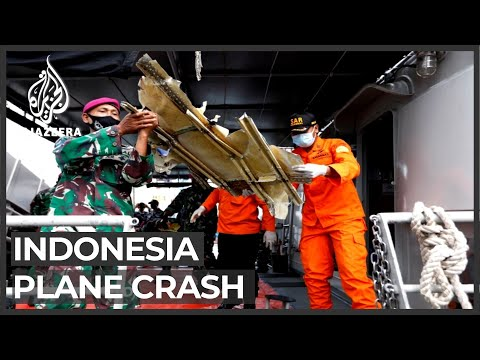 Family, friends of Indonesia plane crash passengers await news