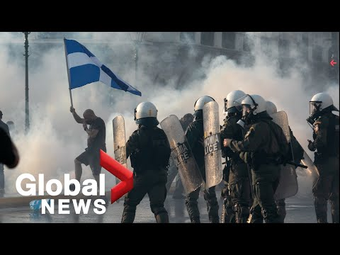Greek police clash with protesters at rally against COVID-19