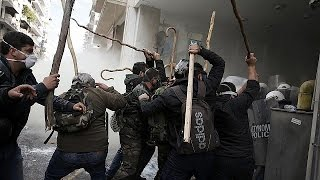 Greek farmers protesting pension reform plans clash with riot police