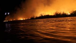 Fire on the banks of the Colorado River, Ocean to Ocean Highway Bridge, Gateway Park, Yuma, AZ
