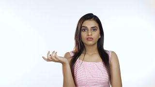 Worried Indian woman looking frightened and closing mouth with her hand - isolated over white background
