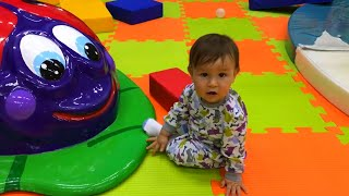 Cute Baby playing on the Indoor Playground and Learning to Walk