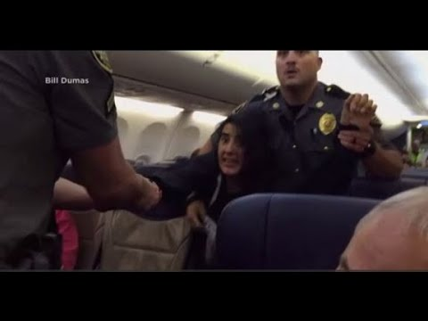 VIDEO: Woman dragged off Southwest Airlines flight