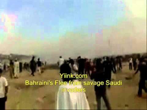 03/2011 Bahrain Uprising Protesters  flee Saudi Arabian Security Killing Machine.wmv