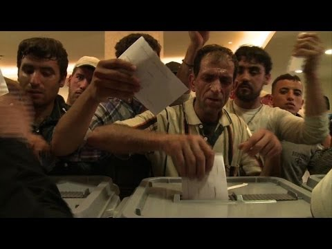 Syrians in Beirut stream to their embassy to vote