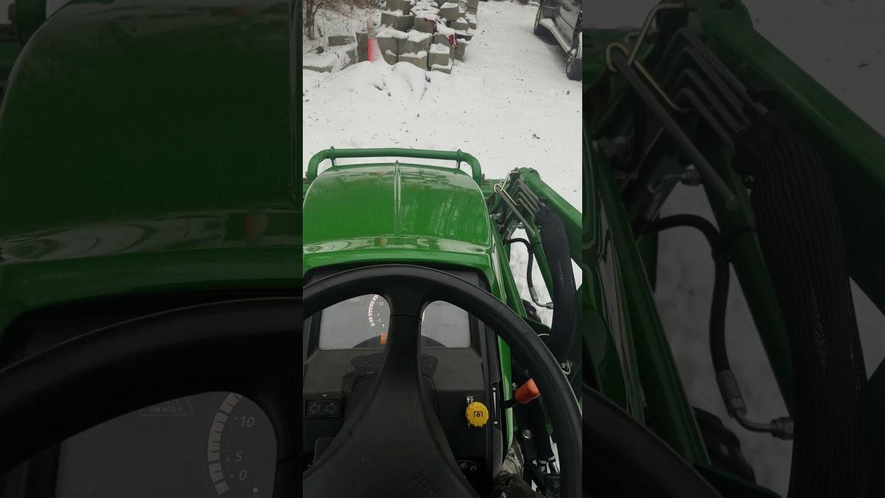 John Deere 1026r using float feature plowing