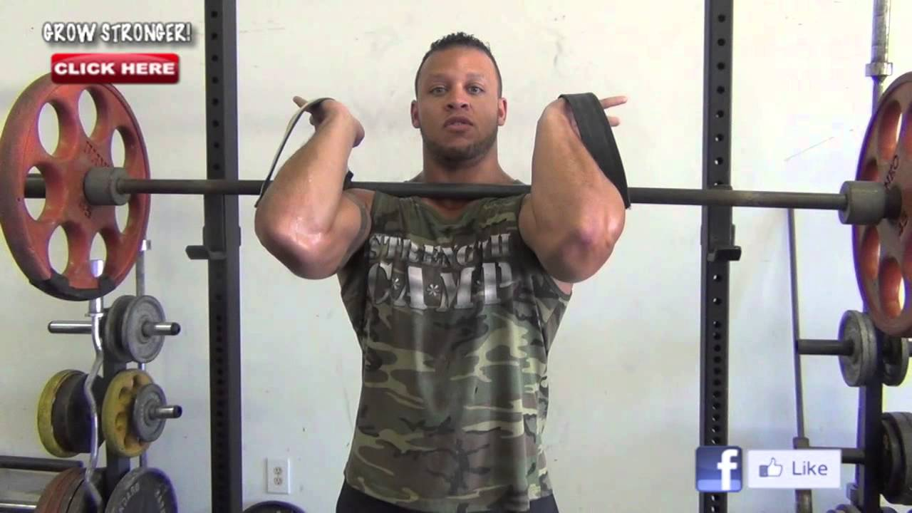 Front squatting with a barbell. Front squats with dumbbells 49
