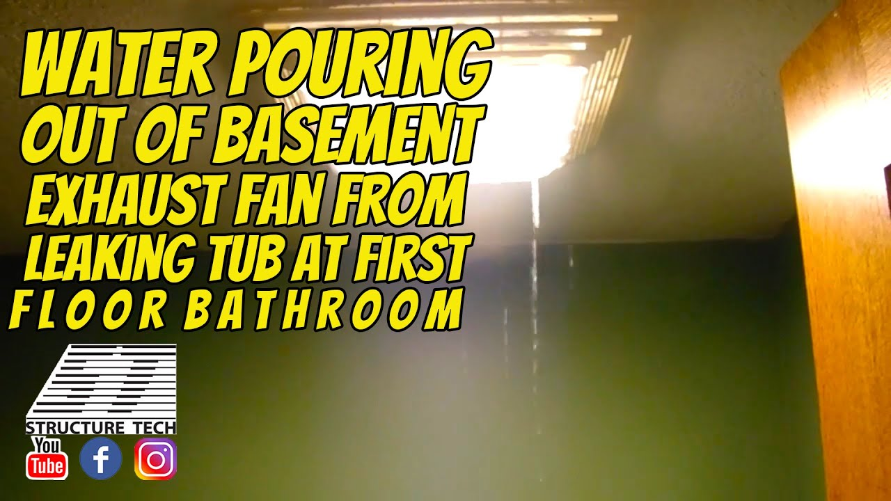 Water pouring out of basement exhaust fan from leaking tub at