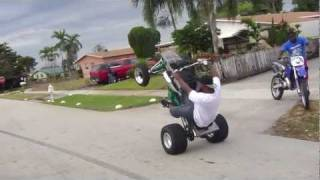 SNAP WHEEL STANDING A 4 WHEELER IN SLOW MOTION!! & SLOW DIRT BIKE!!