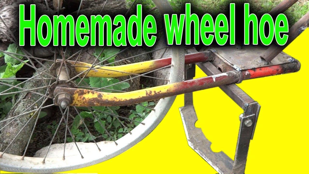 Homemade wheel hand hoe garden wheel hoe youtube for Garden tools for 4 wheeler