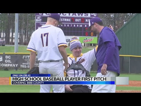 Bibb County high school students throws first pitch
