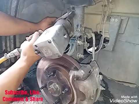 Membuka Absorber Nissan Latio 2008