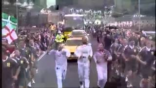 Muse carrying the Olympic Torch May 20, 2012