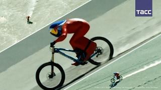 Австриец побил мировой рекорд по скоростному спуску на горном велосипеде по гравию(Австриец побил мировой рекорд по скоростному спуску на горном велосипеде по гравию 42-летний Макс Штокль..., 2017-02-09T15:40:15.000Z)