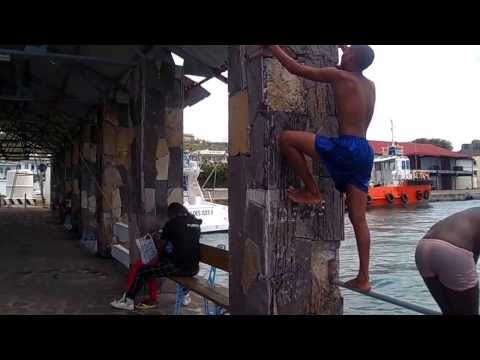 Rodriguans swimming and diving on the Quay in Port Mathurin Rodrigues on 1st January
