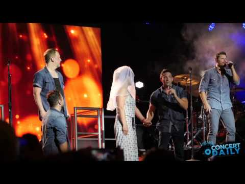 98 Degrees pulls fan on stage + performs