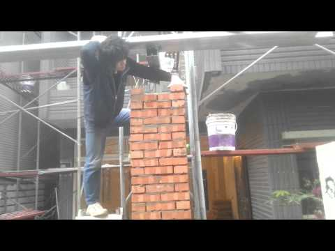 Bricklaying to reinforce steel beam structure