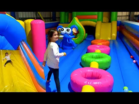 Emily Jumping on the Giant Bouncy Castles - Kids Songs