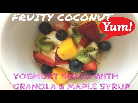 HEALTHY FRUITY COCONUT YOGHURT SNACK WITH GRANOLA AND MAPLE SYRUP
