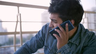 Attractive India guy talking to his friend over a phone call - technology concept