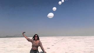 Stunning Burning Man Art Work Showpiece Balloon Chain in hands of Burners on bikes welcomed to ride