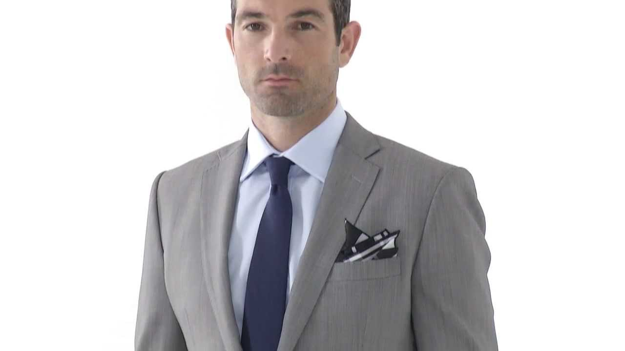 Light grey mens tailored suit in grey birds-eye fabric - by