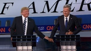 Trump gives Bush a low-five after debate joke