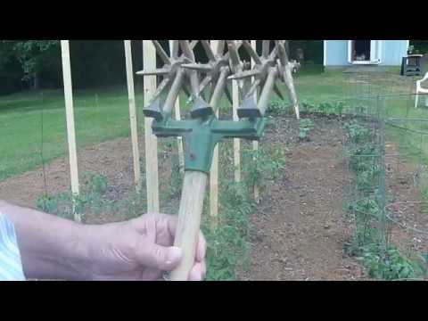Getting grass out of backyard garden with a hand cultivator YouTube
