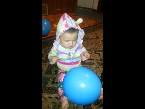 Baby scared from balloon