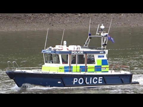 Police boat patrolling London Thames - Metropolitan Police Marine Unit