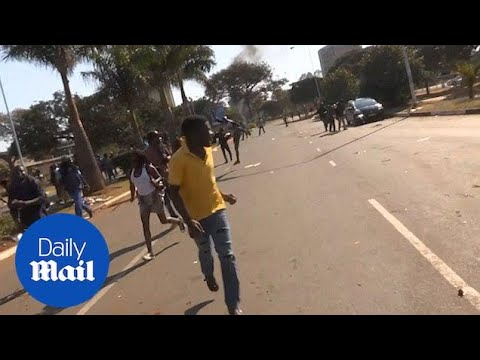 Gunfire disperses as angry opposition protests election result