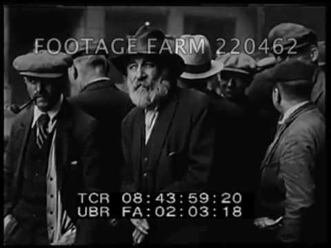 Unemployed Men Receiving Coins - 220462-09 | Footage Farm