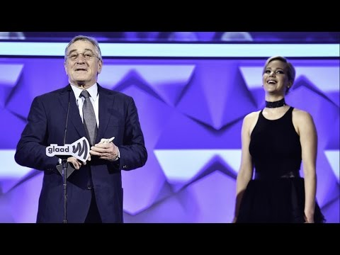 Jennifer Lawrence presents the Excellence in Media Award to Robert De Niro