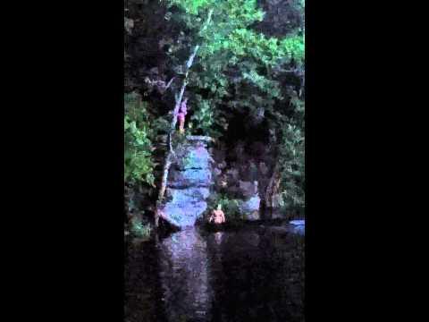 Ariel jumping off rock at Herrington lake