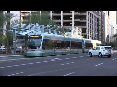 VALLEY METRO LIGHT RAIL TRAIN 122 AND 140 ON THE TO MESA DR IN DOWNTOWN PHOENIX