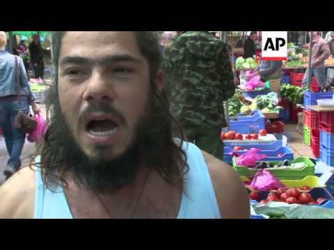 Cypriots consider their country's plight at the local Saturday market