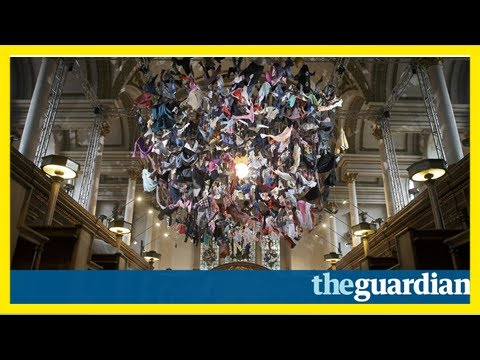 Artist hangs refugees' clothing in london church to highlight crisis