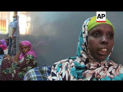 Migrants flee detention centre in clashes area to safe areas in Tripoli