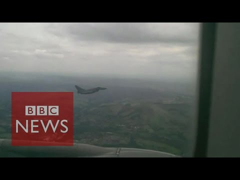 Video shows military jet escorting Qatar Airlines passenger plane to Manchester airport - BBC News