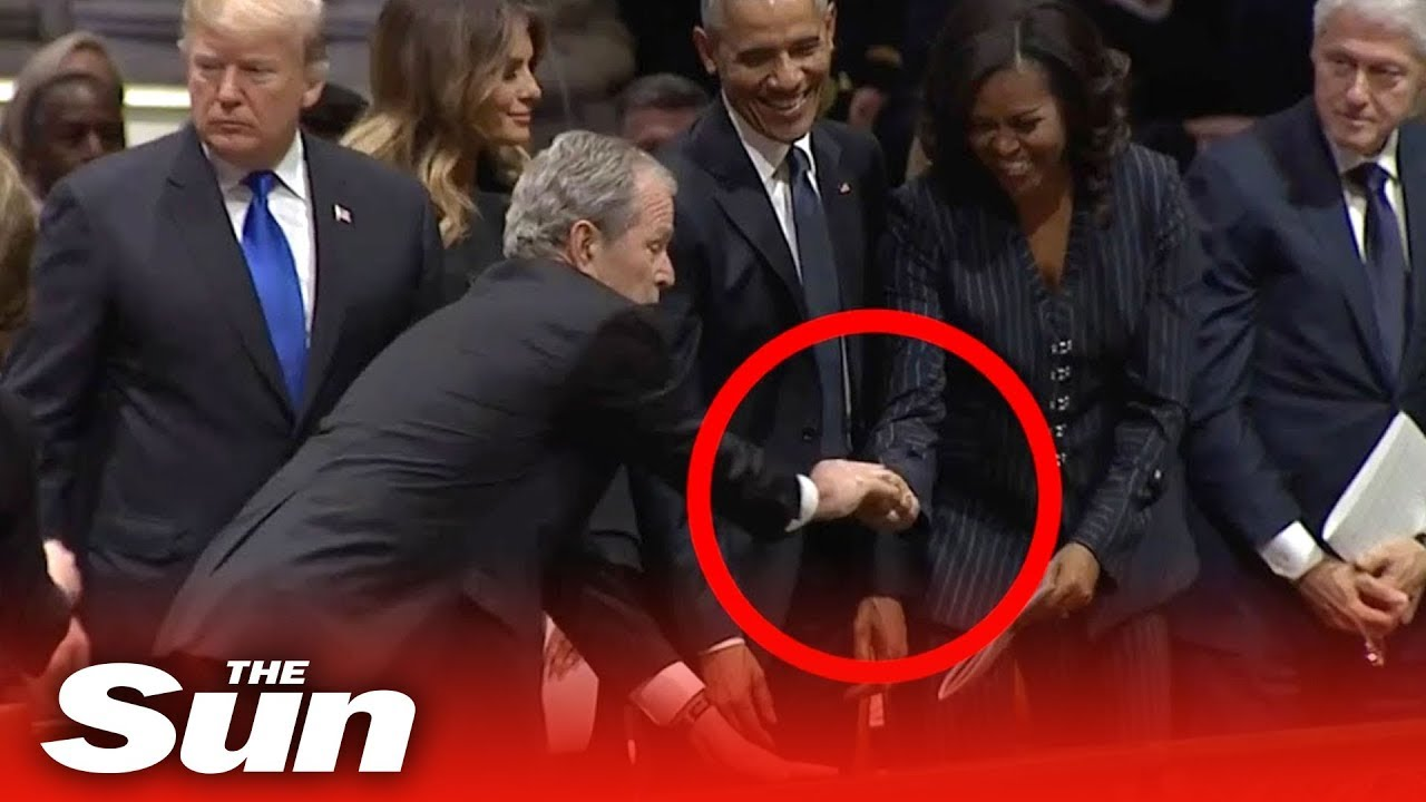 George W Bush gives Michelle Obama a mint at his dad's funeral